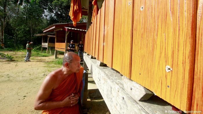 Buddhist monkey shows bullet holes