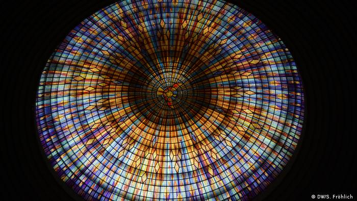 A round stained glass window on the roof of the Basilica of Our Lady of Peace
