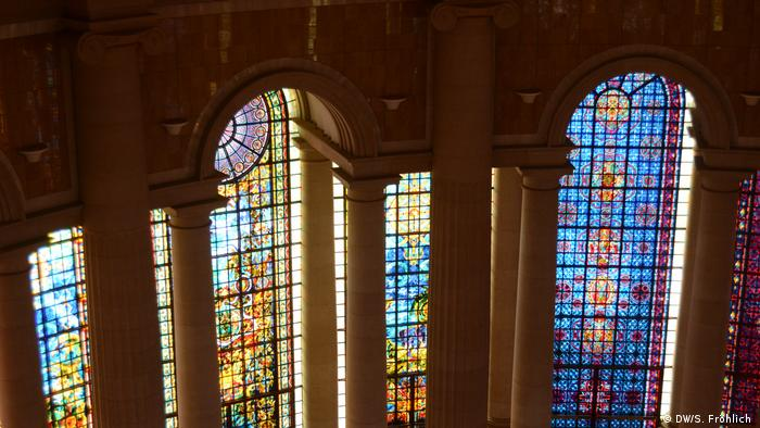 Stained glass windows on the inside of the Basilica Lady of Our Peace