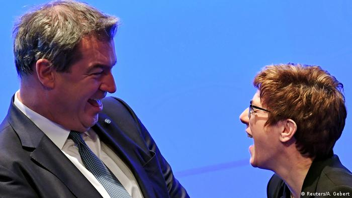 CSU party leader Markus Söder and CDU leader Annegret Kramp-Karrenbauer laugh at a CSU party meeting in Munich, Germany (Reuters/A. Gebert)