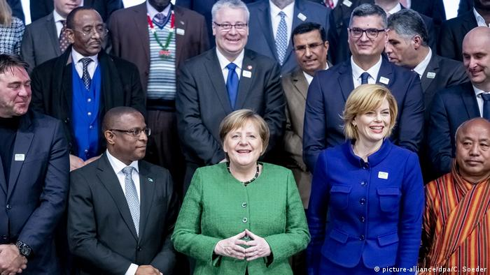 Chancellor Angela Merkel and German Agriculture Minister Julia Klöckner pose together with agriculture ministers from 70 nations in Berlin