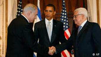 President Barack Obama meets with Israeli Prime Minister Benjamin Netanyahu, left, and Palestinian President Mahmoud Abbas, in New York, Tuesday, Sept. 22, 2009