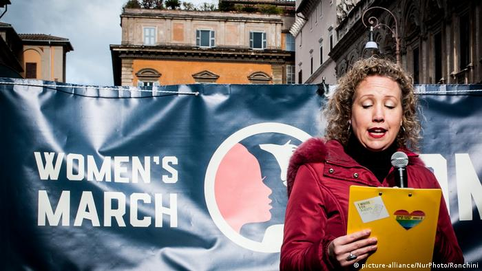 A demonstrator speaks at the Women's March in Rome