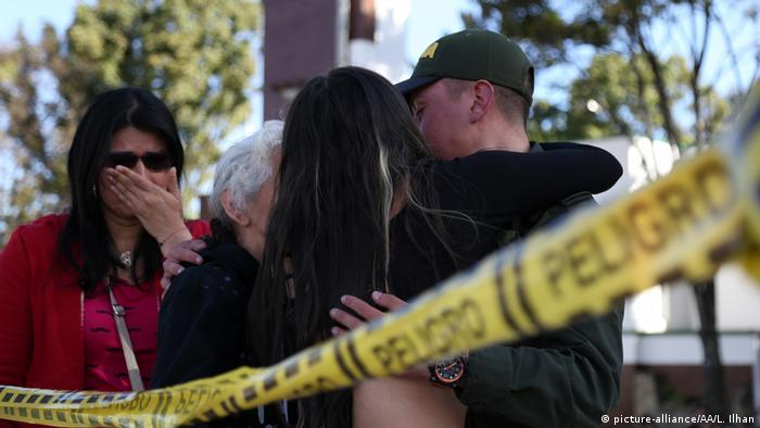 Relatives gather with police after a bombing of a Bogota police academy