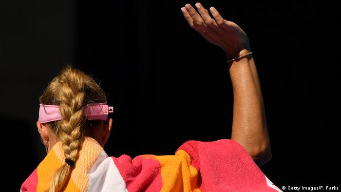 Angelique Kerber waves after her defeat at the Australian Open