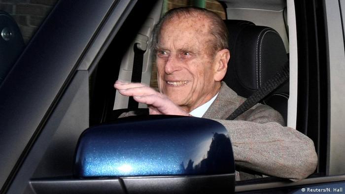 Prince Philip, Duke of Edinburgh, driving an automobile