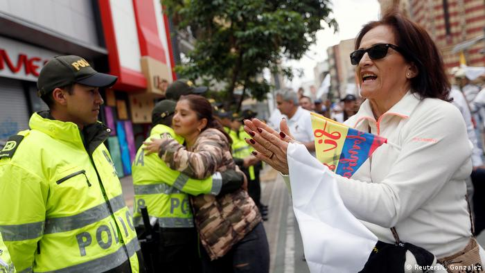 Demonstrators against terror hug police in Colombia