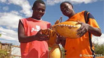 Two Kenyan yoghurt makers holding gourds