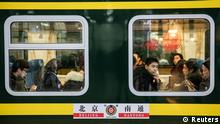 Passengers sit inside the first train that leaves Beijing Railway Station on the first day of the annual Spring Festival travel rush ahead of the Chinese Lunar New Year, in Beijing, China early January 21, 2019. REUTERS/Stringer ATTENTION EDITORS - THIS IMAGE WAS PROVIDED BY A THIRD PARTY. CHINA OUT.