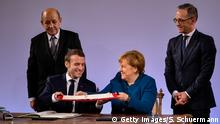AACHEN, GERMANY - JANUARY 22: German Chancellor Angela Merkel and French President Emmanuel Macron sign the Aachen Treaty on January 22, 2019 in Aachen, Germany. The treaty is meant to deepen cooperation between the countries as a means to also strengthen the European Union. It comes 56 years to the day after then German Chancellor Konrad Adenauer and French President Charles de Gaulle signed the Elysee Treaty, or Joint Declaration of Franco-German Friendship. (Photo by Sascha Schuermann/Getty Images)