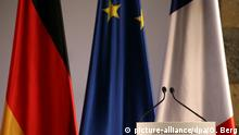 German, French and EU flags
