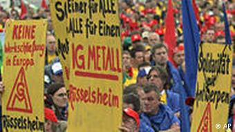 Protestors in front of the Opel factory in Antwerp