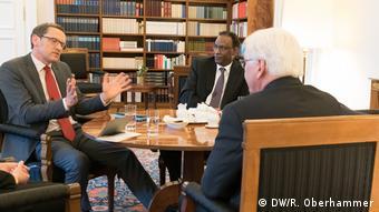 Ludger Schadomsky, Mohammed Negash and Frank-Walter Steinmeier sit around a table talking