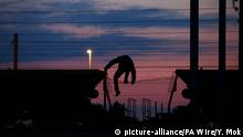 Silhouette of a migrant near the Eurotunnel in Calais