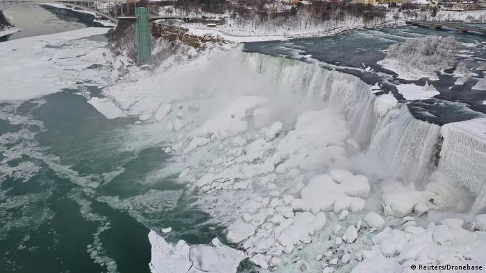 Water crashes onto large chunks of ice which have formed at the base of the Niagara Falls (Reuters/Dronebase)