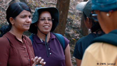 Divya Divakaran (left) spearheaded protests to gain access to the peak