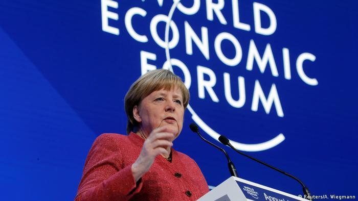 Angela Merkel speaks at Davos (Reuters/A. Wiegmann)