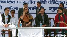 ARCHIV 2005 +++ Indian Congress Party president Sonia Gandhi, , second left, sits along with family members Rahul Gandhi, left, Robert Vadhera, second right, and Priyanka Gandhi at a public meeting after inaugurating the Indira Gandhi Eye Care and Research Center at Sanjay Gandhi Hospital in Munshiganj, near Amethi, India, Sunday, Dec. 5, 2005. (AP Photo/Ajay Kumar Singh)  