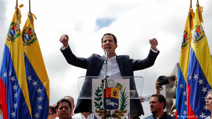Juan Guaido, President of Venezuela's National Assembly, reacts during a rally against Venezuelan President Nicolas Maduro's government
