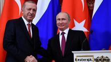 Russian President Vladimir Putin and his Turkish counterpart Recep Tayyip Erdogan shake hands at the end of a joint press conference following their meeting at the Kremlin in Moscow, Russia, January 23, 2019. Aleksander Nemenov/Pool via REUTERS