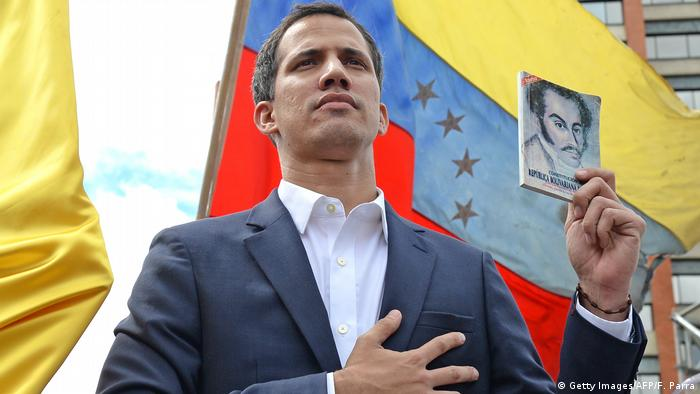 Juan Guaido declaring himself acting president of Venezuela in Caracas