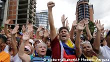 23.01.2019 Anti-government protesters cheer after Juan Guaido, head of Venezuela's opposition-run congress, declares himself interim president of the South American country until new elections can be called, at a rally demanding the resignation of President Nicolas Maduro, in Caracas, Venezuela, Wednesday, Jan. 23, 2019. (AP Photo/Boris Vergara)
