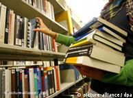 A student takes books of shelves in the Wuerzburg University library