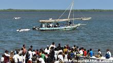 People look at the dhow, made by recycled plastic, as it floats during its official voyage launch at Lamu Island, northern coast of Kenya, on January 23, 2019. - Flipflopi, the worlds first 100% recycled plastic dhow, embarks on its 500 km maiden voyage from Lamu on January 23, 2019, Kenya to Tanzania's Zanzibar, visiting schools, communities and government officials, sharing solutions and changing mindsets along the way. Supported by UN Environments CleanSeas Program, the expedition will raise awareness for the more than 12m tonnes of plastic being in dumped in the ocean every year. (Photo by ANDREW KASUKU / AFP) (Photo credit should read ANDREW KASUKU/AFP/Getty Images)