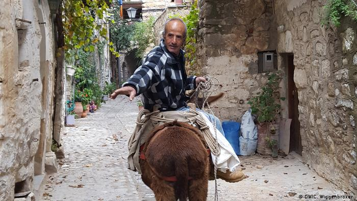 Resident of Mesta, Chios, riding a mule