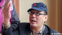 Yang Hengjun, author and former Chinese diplomat, who is now an Australian citizen, gestures in an unspecified location in Tibet, China, sometime in mid-July, 2014 in this social media image obtained by REUTERS ATTENTION EDITORS - THIS IMAGE WAS PROVIDED BY A THIRD PARTY. NO RESALES. NO ARCHIVES. THIS PICTURE WAS PROCESSED BY REUTERS TO ENHANCE QUALITY. AN UNPROCESSED VERSION HAS BEEN PROVIDED SEPARATELY.
