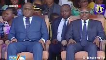 24.01.2019 +++ Democratic Republic of Congo's outgoing President Joseph Kabila sits next to his successor Felix Tshisekedi during an inauguration ceremony whereby Tshisekedi will be sworn into office as the new president of the Democratic Republic of Congo at the Palais de la Nation in Kinshasa, Democratic Republic of Congo, January 24, 2019, in this screen grab taken from video. Reuters TV via REUTERS THE DEMOCRATIC REPUBLIC OF THE CONGO OUT. NO COMMERCIAL OR EDITORIAL SALES IN THE DEMOCRATIC REPUBLIC OF THE CONGO