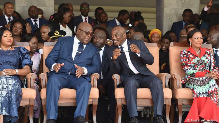 Joseph Kabila sits next to Felix Tshisekedi during the inauguration in Kinshasa (Reuters/O. Acland)