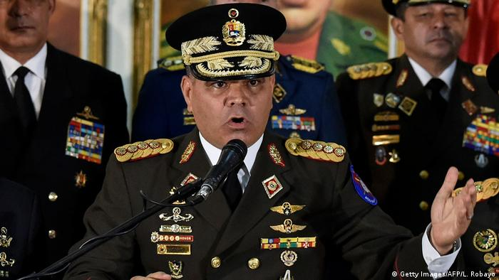 Vladimir Padrino Lopez speaks in full military uniform into a microphone (Getty Images/AFP/L. Robayo)