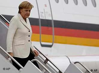 German Chancellor Angela Merkel arrives at Pittsburgh International Airport in Coraopolis, Pa., Thursday, Sept. 24, 2009. Merkel will be attending the G-20 Summit in Pittsburgh. (AP Photo/Carolyn Kaster)