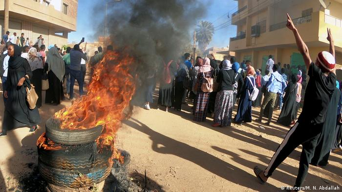 Sudanese demonstrators burn tyres as they take part in anti-government protests