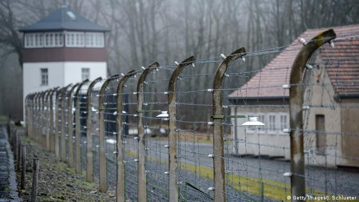 The barbed-wire fencing running along the exterior of the former Buchenwald death camp (Getty Images/J. Schlueter)