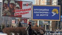 January 19, 2019 - Kiev, Ukraine - A woman with a baby carriage walks next to the election political billboards of head of the Radical party Oleg Lyashko with a slogan Lyashko -people s president! and the Opposition platform-for life in sunny winter day in Kiev, Ukraine, on 19 January, 2019. Presidental election will be held in Ukraine on March 31. Kiev Ukraine PUBLICATIONxINxGERxSUIxAUTxONLY - ZUMAn230 20190119_zaa_n230_1559 Copyright: xStrx