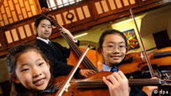 Violinists Julia Hwand and Lana Trimmer, with Bassist Ha-Young Jung