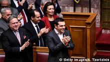 Greece's Prime Minister Alexis Tsipras celebrates after a voting session on the Prespa Agreement, an agreement aimed at ending a 27-year bilateral row by changing the name of Macedonia to the Republic of North Macedonia, at the Greek Parliament, in Athens, on January 25, 2019. - Greek lawmakers ratified a landmark name change deal with neighbouring Macedonia, handing Prime Minister Alexis Tsipras a diplomatic triumph and bucking street protests to end one of the world's most stubborn diplomatic disputes. (Photo by ANGELOS TZORTZINIS / AFP) (Photo credit should read ANGELOS TZORTZINIS/AFP/Getty Images)