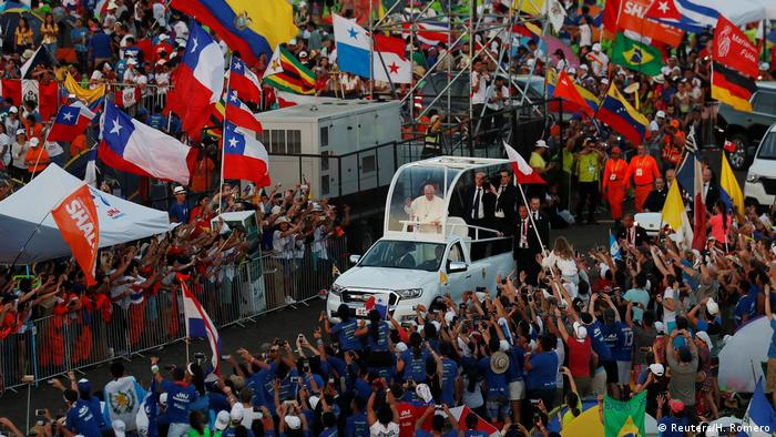 The pope made his way in his popemobile through cheering crowds of youth to the Saturday morning vigil