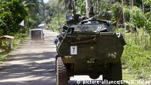 27.04.2016 epa05279153 Filipino soldiers in a military tank transit at a road on the outskirts of Jolo, Sulu Island, southern Philippines, 27 April 2016. The Armed Forces of the Philippines (AFP) and the Philippine National Police (PNP) vowed to 'neutralize' Abu Sayyaf terrorists after the beheading of a Canadian hostage, who was kidnapped from a resort in the southern Philippines along with three others in September. 'There will be no let-up in the determined efforts of the joint AFP- PNP task group's intensive military and law enforcement operations to neutralize these lawless elements and thwart further threats to peace and security,' said the army and the police in a statement issued. 'The President has directed the security forces to apply the full force of the law to bring these criminals to justice,' read the statement, in which authorities also conveyed condolences to the Canadian government and the family of the victim John Ridsdel. EPA/BEN HAJAN |