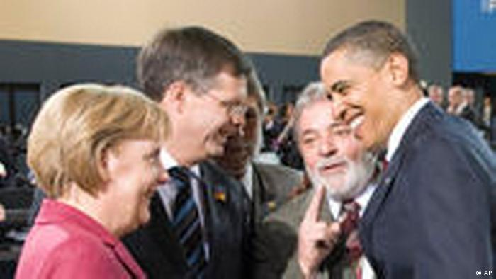 Angela Merkel, Jan Peter Balkenende, Lula e Barack Obama conversam animadamente