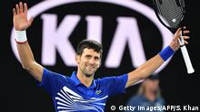 27.01.2019 Serbia's Novak Djokovic celebrates his victory against Spain's Rafael Nadal during the men's singles final on day 14 of the Australian Open tennis tournament in Melbourne on January 27, 2019. (Photo by SAEED KHAN / AFP) / -- IMAGE RESTRICTED TO EDITORIAL USE - STRICTLY NO COMMERCIAL USE -- (Photo credit should read SAEED KHAN/AFP/Getty Images)