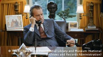 A portrait of Richard Nixon on the telephone in his office from the 2019 film Watergate