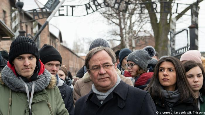 Armin Laschet surrounded by Muslim, Christian and Jewish young people from his state of North-Rhine Westphalia who accompanied him to Auschwitz in 2019