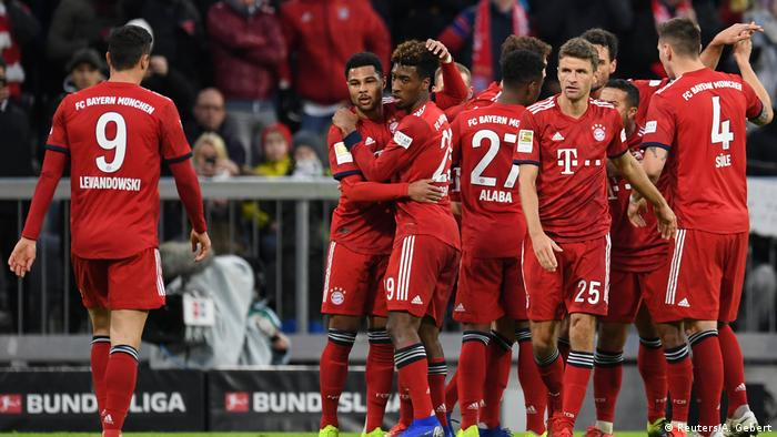 78d7e5728e Bayern Munich score four to answer Borussia Dortmund′s challenge ...