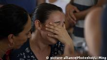 (190127) -- BRUMADINHO, Jan. 27, 2019 -- A relative of missing people cries in a helping center near Brumadinho, the state of Minas Gerais, Brazil, on Jan. 26, 2019. At least 34 people were killed after a tailings dam owned by mining giant Vale collapsed Friday afternoon in Brazil's southeastern state of Minas Gerais. (/Li Ming)  
