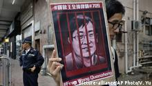 13.07.2018 A protester holds a picture of imprisoned and prominent Chinese human rights lawyer Wang Quanzhang during a protest outside the Chinese liaison office in Hong Kong, Friday, July 13, 2018, to mark the first death anniversary of Liu Xiaobo, China's most prominent political prisoner, and Nobel Peace Prize laureate. (AP Photo/Vincent Yu)  