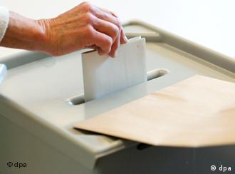 woman casting election ballot