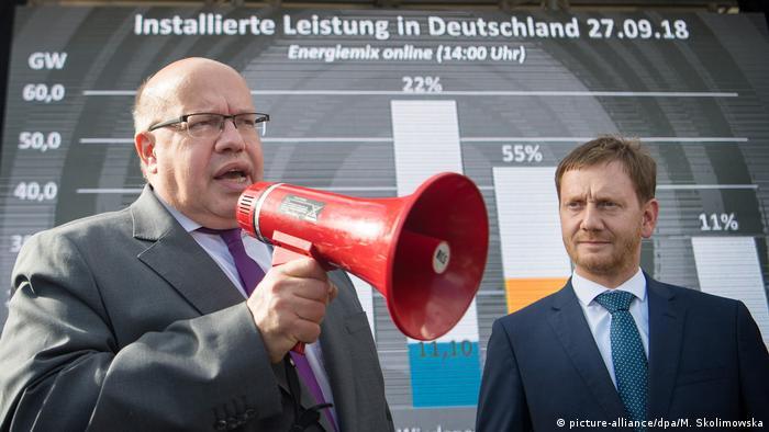 Peter Altmaier speaking into megaphone